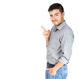 Young man pointing his finger on the copy space at white background. Latin man isolated pointing something stock photography