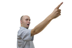 Young man pointing with his finger on white background Royalty Free Stock Image