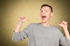 Young man pointing itself Stock Images
