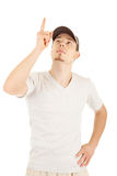 Young man is pointing and looking up Royalty Free Stock Photography