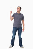 Young man pointing and looking up Stock Photos