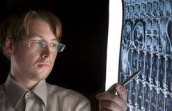 Young man pointing at MRI royalty free stock photos