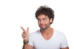 Young Man Pointing Out With Finger Stock Images