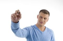 Young man pointing with pen Royalty Free Stock Photos