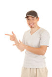 Young man is pointing sideways Royalty Free Stock Photo