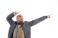 Young man pointing sideways Royalty Free Stock Image