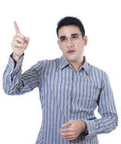A young man pointing at something Royalty Free Stock Photos