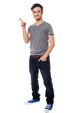 Young man pointing at something interesting Stock Images