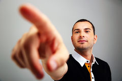 Young man pointing on something Stock Photo