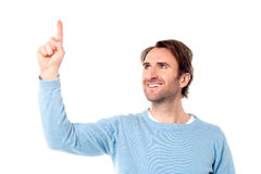 Young man pointing at something Royalty Free Stock Photo