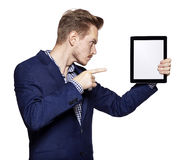 Young man pointing at tablet PC Stock Images