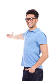 Young man pointing to the back Stock Photo
