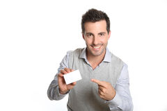 Young man pointing to blank card Stock Images