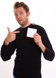 Young man pointing to a blank note Royalty Free Stock Photo
