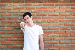 Young man pointing to the camera Stock Images