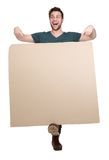 Young man pointing to empty poster Royalty Free Stock Photos