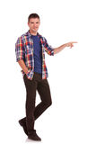 Young man pointing towards something Stock Photos