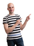 Young man pointing towards something interesting Stock Image