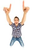 Young man pointing up Stock Images