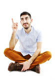 Young man pointing up Stock Photos