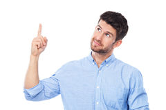 Young man pointing up Royalty Free Stock Photo