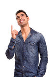 Young man pointing up Stock Image