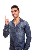 Young man pointing up Royalty Free Stock Images