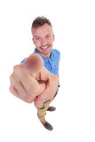 Young man pointing up at you Stock Photo