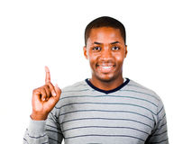 Young man pointing upwards Royalty Free Stock Photos