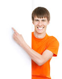 Young man pointing on white background Royalty Free Stock Image