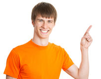 Young man pointing on white background Stock Photo