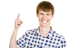 Young man pointing on white background Royalty Free Stock Photo