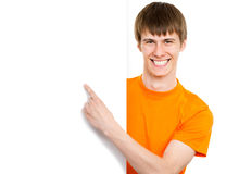 Young man pointing on white background Stock Photos