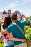 Young man pointing woman the castle architecture Royalty Free Stock Photography