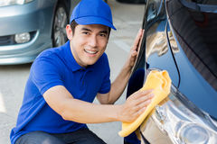 Young man polishing cleaning car with microfiber cloth. Car detailing, valeting  and auto service concepts Stock Photo
