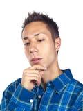 Young man pondering Stock Photos