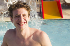 Young man at the pool looking happy Stock Photo