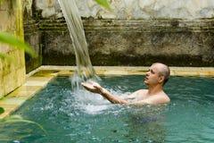 Young man in the pool. Young man in the pool in a luxury villa stock images
