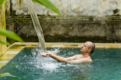Young man in the pool. Young man in the pool in a luxury villa Royalty Free Stock Image