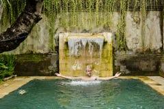 Young man in the pool. Young man in the pool in a luxury villa Stock Photos