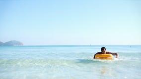 Young man on pool raft Stock Photo
