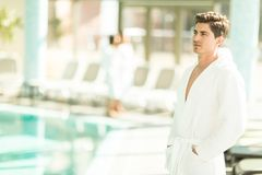Young man by the pool Royalty Free Stock Photography