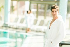 Young man by the pool Stock Images