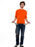 Young man poor showing empty pockets Stock Photography