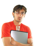 Young Man with a portfolio. A young man wearing glasses is holding a work or school portfolio Royalty Free Stock Photography