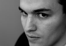 Young Man Portrait, Black and White. Portrait of a young man in black and white stock photography