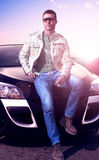 Young man portrait and car Royalty Free Stock Images