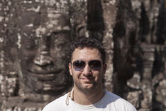 Happy young man in Angor Wat Stock Photos