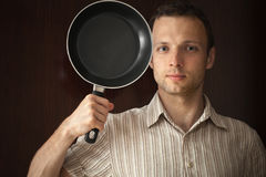 Young man portrait with frying pan Royalty Free Stock Images