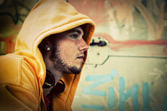 Young man portrait, grunge wall Royalty Free Stock Image